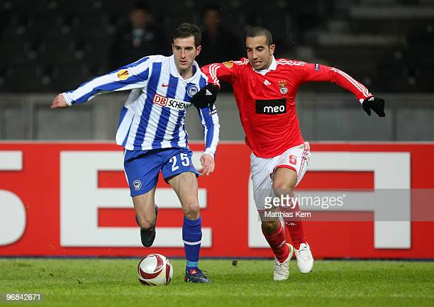 Ruben Amorim of Lisbon battles for the ball with Maximilian Nicu of Berlin during the UEFA Europa League knock-out round, first leg match between...