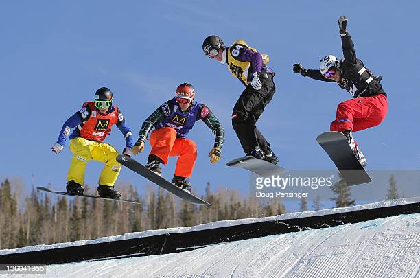 Ruben Arnold of Switzerland, Seth Wescott, Michael Haemmerle of Austria and Michal Novotny of the Czech Republic descend the course in the quarter...