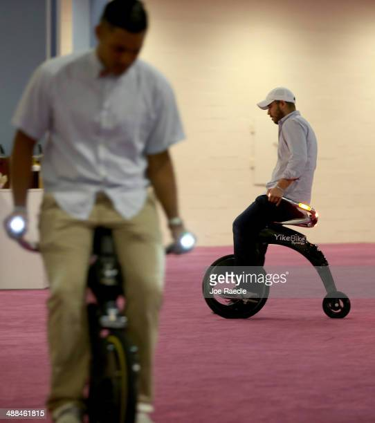 Ruben Barzilay rides the electric powered YikeBike on display at the eMerge Americas Techweek held in the Miami Beach Convention Center on May 6 2014...