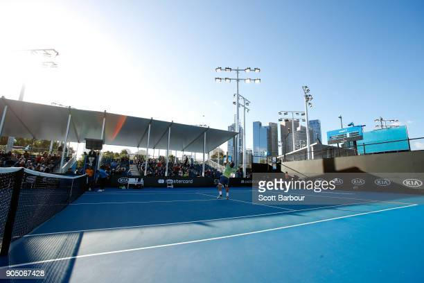 Ruben Bemelmans of Belgium plays a smash in his first round match against Lucas Pouille of France on day one of the 2018 Australian Open at Melbourne...