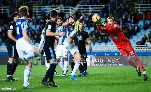 Ruben Blanco of RC Celta de Vigo duels for the ball with Imanol Agirretxe of Real Sociedad during the La Liga match between Real Sociedad de Futbol...