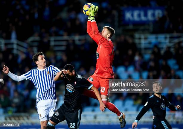 Ruben Blanco of RC Celta de Vigo duels for the ball with Mikel Oyarzabal of Real Sociedad during the La Liga match between Real Sociedad de Futbol...