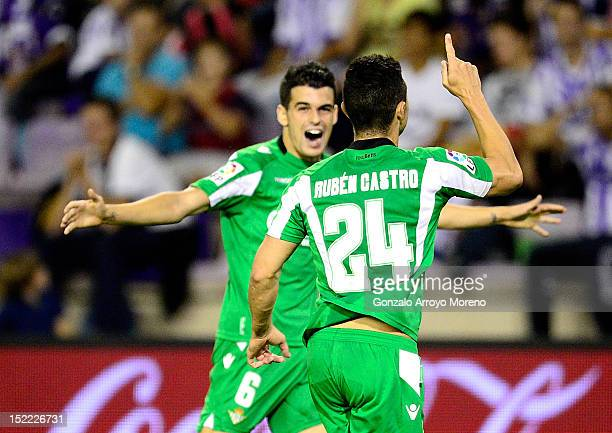 Ruben Castro of Real Betis celebrates his goal with teammate Alex Martinez during the La Liga football match between Real Valladolid CF and Real...