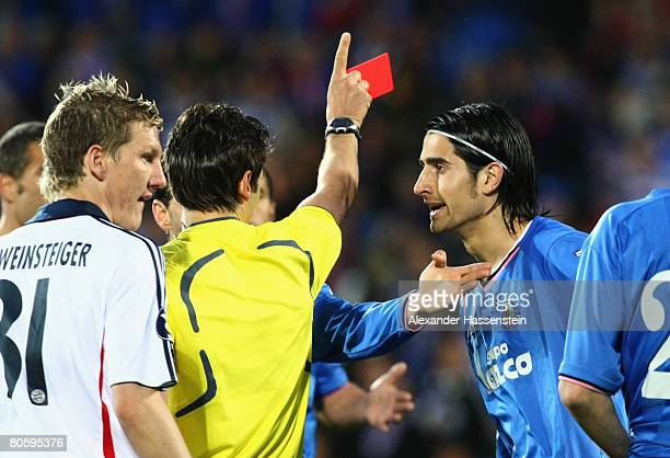 Ruben De La Red of Getafe receives the Red Card from Referee Massimo Busacca during the UEFA Cup quarter final second leg match between CF Getafe and...