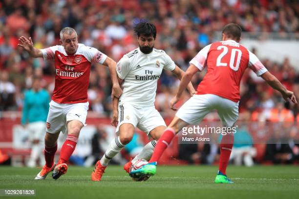 Ruben De La Red of real Madrid in action with Nigel Winterburn and Matthew Upson of Arsenal during the match between Arsenal Legends and Real Madrid...