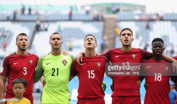Ruben Dias Diogo Costa Diogo Dalot Jorge Fernandes and Jose Gomes of Portugal sing their national anthem during the FIFA U20 World Cup Korea Republic...