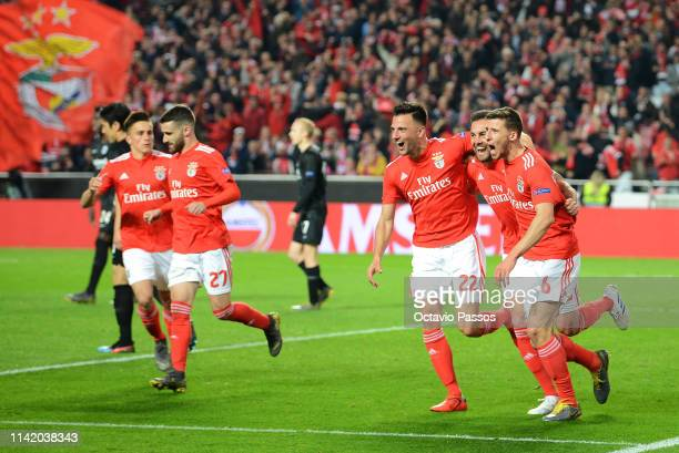 Ruben Dias of Benfica celebrates with teammates after scoring their team's third goal during the UEFA Europa League Quarter Final First Leg match...