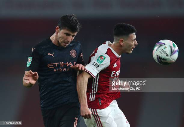 Ruben Dias of Manchester City and Gabriel Martinelli of Arsenal challenge for a header during the Carabao Cup Quarter Final match between Arsenal and...