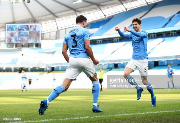 Ruben Dias of Manchester City celebrates after scoring his teams first goal during the Premier League match between Manchester City and West Ham...