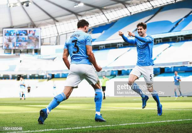 Ruben Dias of Manchester City celebrates with John Stones after scoring his teams first goal during the Premier League match between Manchester City...