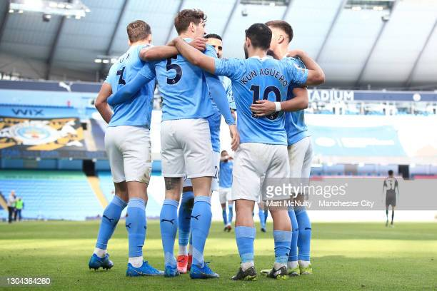 Ruben Dias of Manchester City celebrates with teammates after scoring his team's first goal during the Premier League match between Manchester City...