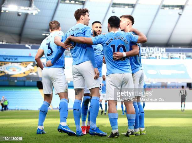 Ruben Dias of Manchester City celebrates with teammates after scoring his teams first goal during the Premier League match between Manchester City...