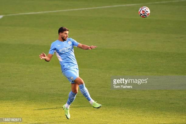 Ruben Dias of Manchester City heads the ball during the pre-season friendly match between Manchester City and Blackpool at Manchester City Football...