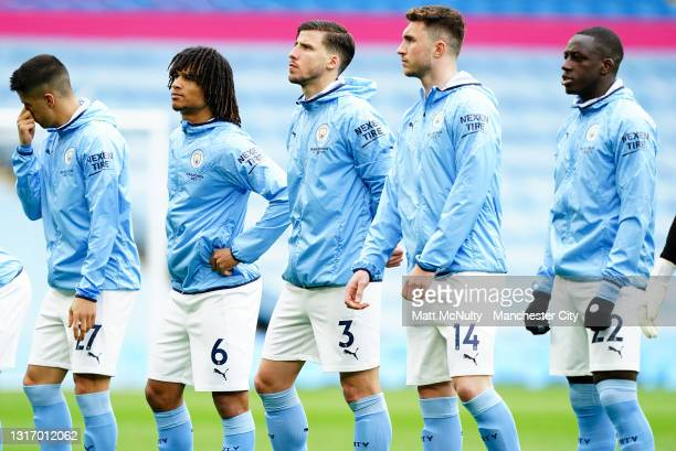 Ruben Dias of Manchester City lines up with teammates during the Premier League match between Manchester City and Chelsea at Etihad Stadium on May...