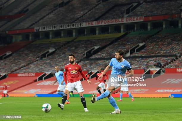 Ruben Dias of Manchester City passes the ball beyond Bruno Fernandes of Manchester United during the Carabao Cup Semi Final match between Manchester...