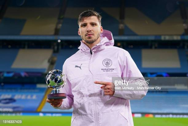 Ruben Dias of Manchester City poses for a photo with the UEFA Player of the match award after the UEFA Champions League Semi Final Second Leg match...