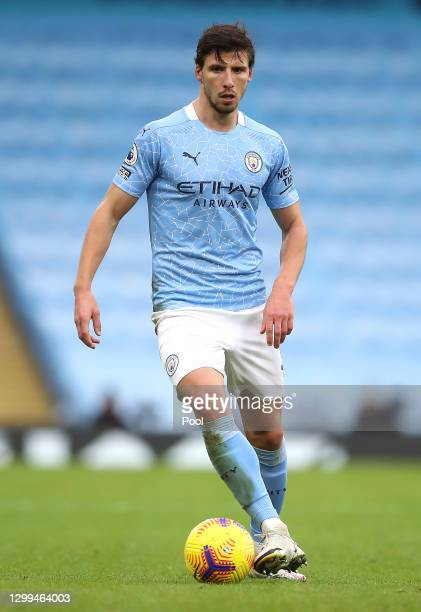Ruben Dias of Manchester City runs with the ball during the Premier League match between Manchester City and Sheffield United at Etihad Stadium on...