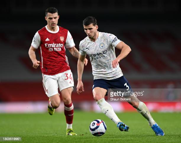Ruben Dias of Manchester City runs with the ball during the Premier League match between Arsenal and Manchester City at Emirates Stadium on February...