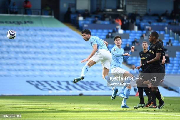 Ruben Dias of Manchester City scores his team's first goal during the Premier League match between Manchester City and West Ham United at Etihad...