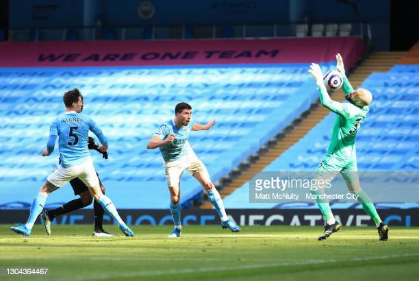 Ruben Dias of Manchester City scores his teams first goal during the Premier League match between Manchester City and West Ham United at Etihad...