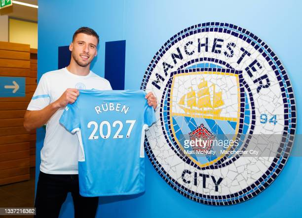 Ruben Dias of Manchester City signs a contract extension at Manchester City Football Academy on August 30, 2021 in Manchester, England.
