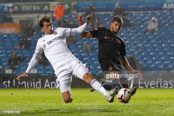 Ruben Dias of Manchester City tackles Patrick Bamford of Leeds United during the Premier League match between Leeds United and Manchester City at...