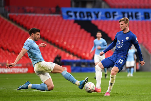 Ruben Dias of Manchester City tackles Timo Werner of Chelsea during the Semi Final of the Emirates FA Cup match between Manchester City and Chelsea...