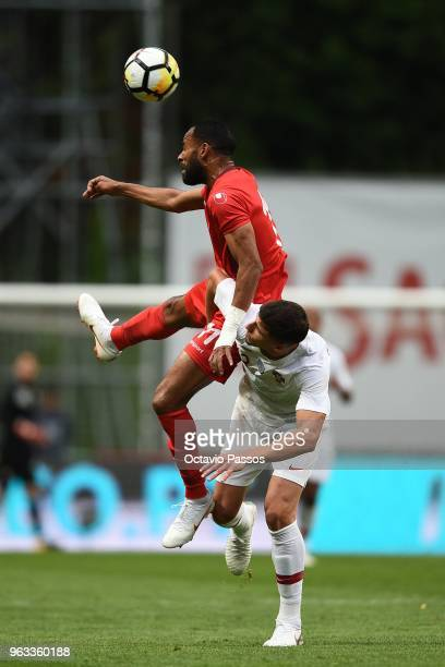Ruben Dias of Portugal competes for the ball with Saber Khalifa of Tunisia during the international friendly football match against Portugal and...