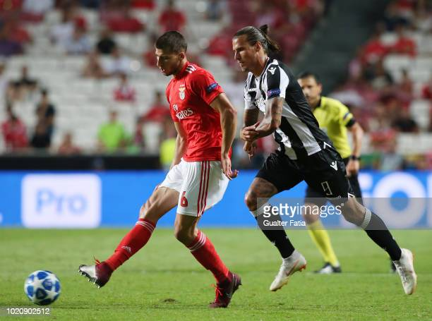 Ruben Dias of SL Benfica with Aleksandar Prijovic of PAOK in action during the UEFA Champions League Play Off match between SL Benfica and PAOK at...