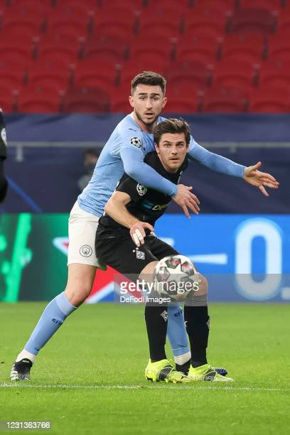 Ruben Diasof Manchester City and Jonas Hofmann of Borussia Moenchengladbach battle for the ball during the UEFA Champions League Round of 16 match...