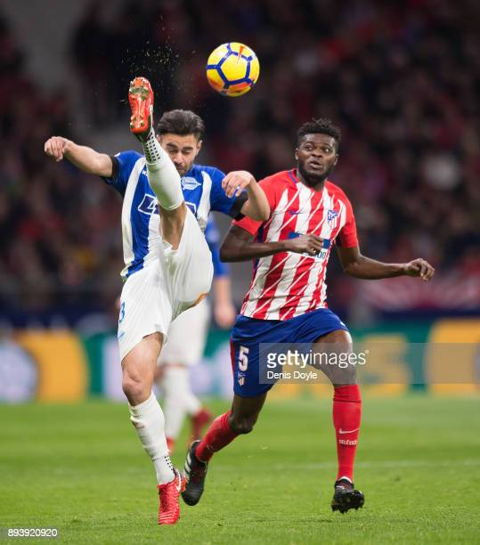Ruben Duarte of Deportivo Alaves clears the ball from Thomas Teve Partey of Club Atletico de Madrid during the La Liga match between Atletico Madrid...