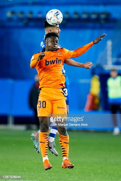 Ruben Duarte of Deportivo Alaves duels for the ball with Yunus Dimoara Musah of Valencia CF during the LaLiga Santander match between Alaves and...