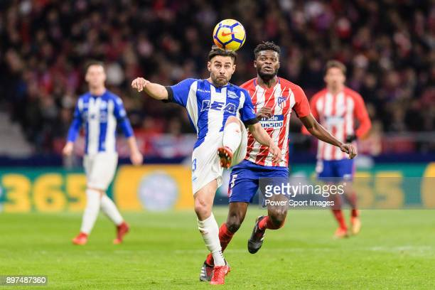 Ruben Duarte of Deportivo Alaves fights for the ball with Thomas Teye Partey of Atletico de Madrid during the La Liga 201718 match between Atletico...