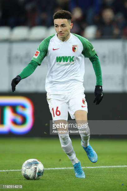 Ruben Estephan Vargas Martinez of Augsburg runs with the ball during the Bundesliga match between FC Augsburg and 1. FSV Mainz 05 at WWK-Arena on...