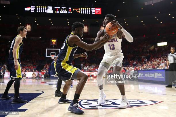Ruben Fuamba of the Northern Arizona Lumberjacks defends Deandre Ayton of the Arizona Wildcats during the first half of the college basketball game...