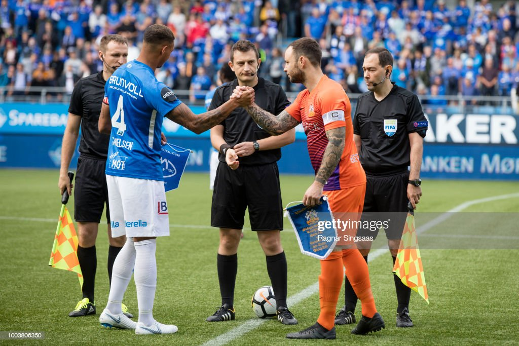 Ruben Gabrielsen Of Molde Fk And Andrew Doyle Of Fc Glenavon Shake Hands Before The Uefa