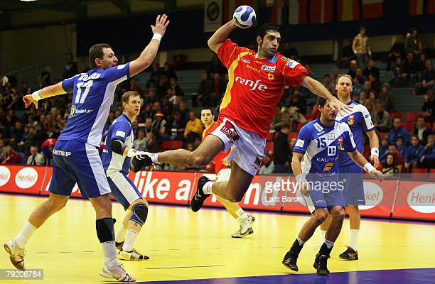 Ruben Garabaya of Spain in action with Sverre Jakobsson and Alexander Petersson of Iceland during the Men's Handball European Championship main round...