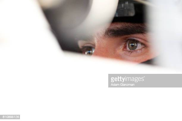 Ruben Garcia Jr driver of the Max Siegel Inc Toyota looks on from his car in the garage during practice before the NASCAR KN Pro Series East at...
