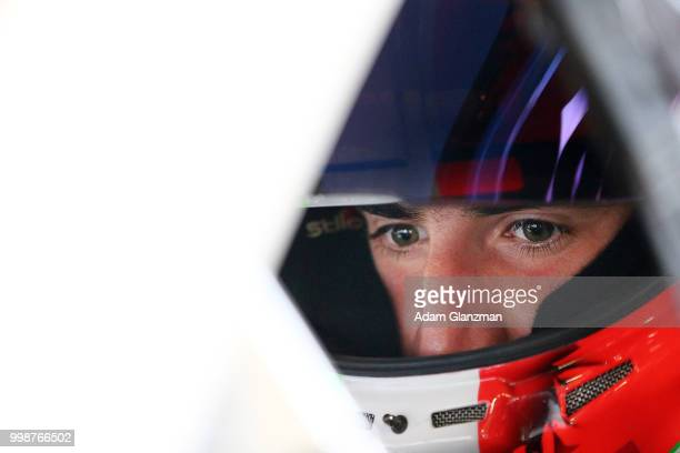 Ruben Garcia Jr driver of the Max Siegel Inc Toyota looks on from the car in the garage during practice the NASCAR KN Pro Series East King Cadillac...