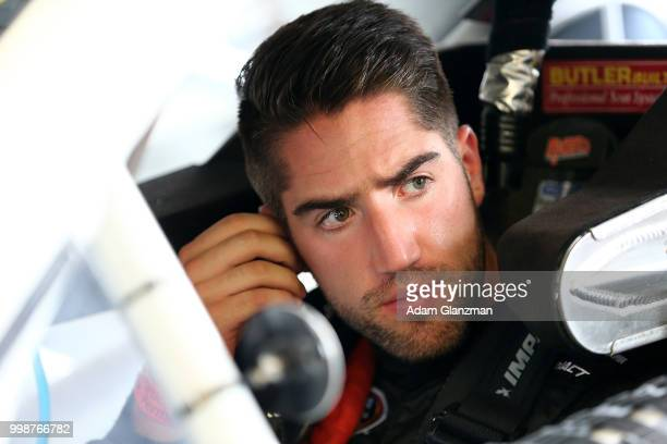 Ruben Garcia Jr driver of the Max Siegel Inc Toyota looks on from the car in the garage during practice for the NASCAR KN Pro Series East King...