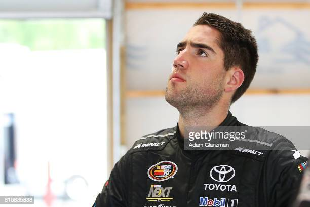 Ruben Garcia Jr driver of the Max Siegel Inc Toyota looks on in the garage during practice before the NASCAR KN Pro Series East at Thompson Speedway...