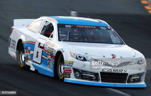 Ruben Garcia Jr driver of the Max Siegel Inc Toyota races during the NASCAR KN Pro Series East United Site Services 70 at New Hampshire Motor...