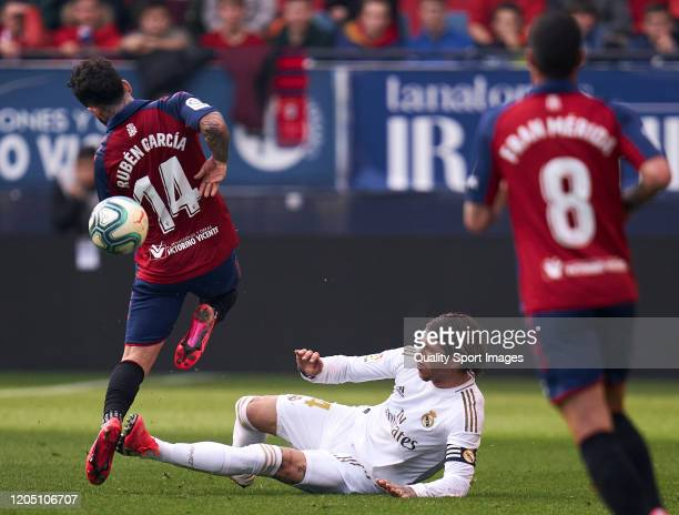 Ruben Garcia of CA Osasuna battle for the ball with Sergio Ramos of Real Madrid CF during the Liga match between CA Osasuna and Real Madrid CF at El...