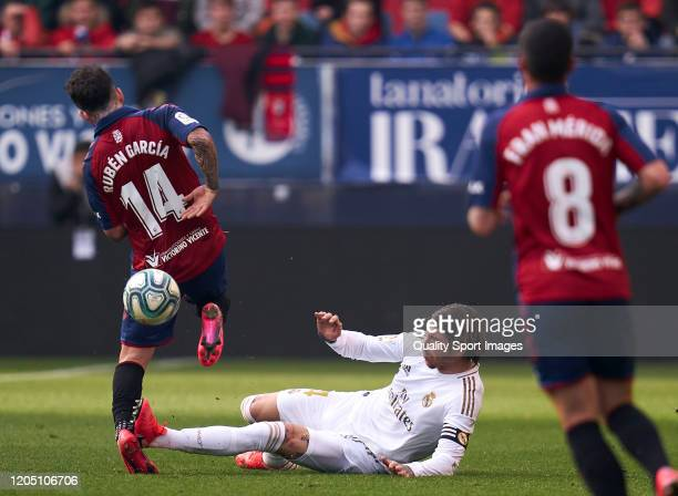 Ruben Garcia of CA Osasuna battles for the ball with Sergio Ramos of Real Madrid CF during the Liga match between CA Osasuna and Real Madrid CF at El...