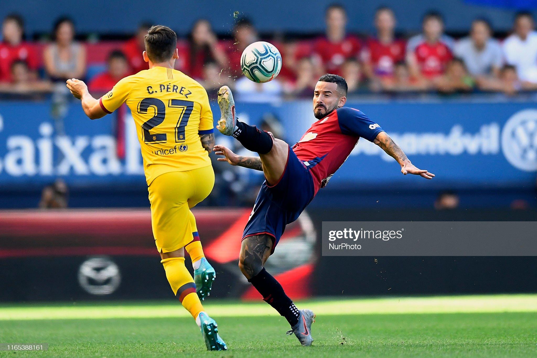 صور مباراة : أوساسونا - برشلونة 2-2 ( 31-08-2019 )  Ruben-garcia-of-osasuna-and-carles-perez-of-barcelona-competes-for-picture-id1165388161?s=2048x2048