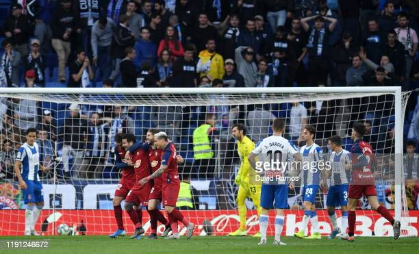 Ruben Garcia of Osasuna celebrates with team mates after he scores his sides first goal during the La Liga match between RCD Espanyol and CA Osasuna...