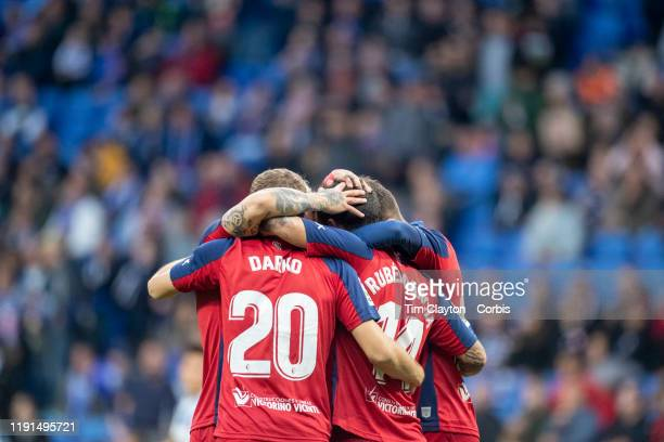 Ruben Garcia of Osasuna is congratulated by team mates Ezequiel Avila of Osasuna Darko Brasanac of Osasuna and Adrian Lopez of Osasuna after scoring...