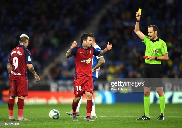 Ruben Garcia of Osasuna is shown the yellow card the La Liga match between RCD Espanyol and CA Osasuna at RCDE Stadium on December 01 2019 in...