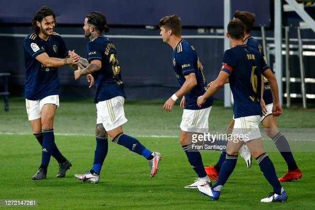 Ruben Garica of CA Osasuna celebrates with his team mates after scoring his sides second goal during the La Liga match between Cadiz and Osasuna at...