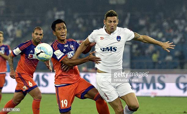 Ruben Gonzalez of Delhi Dynamos FC and Gouramangi Singh of FC Pune City during the India Super League football match on October 27 2016 in New Delhi...